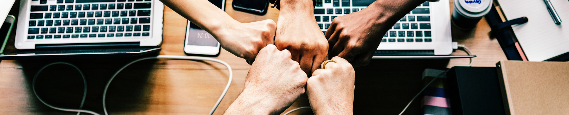 5 people fist bumping