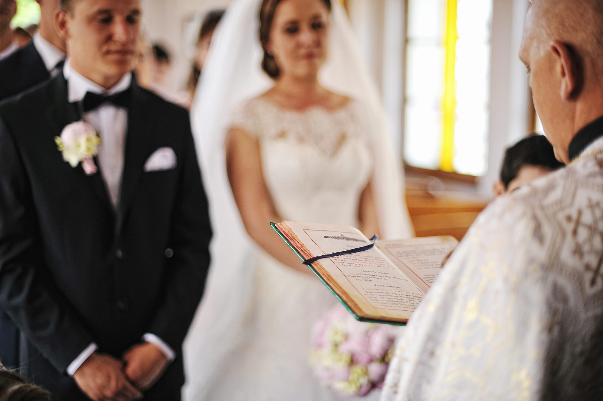 Priest read a holy bible book background newlyweds