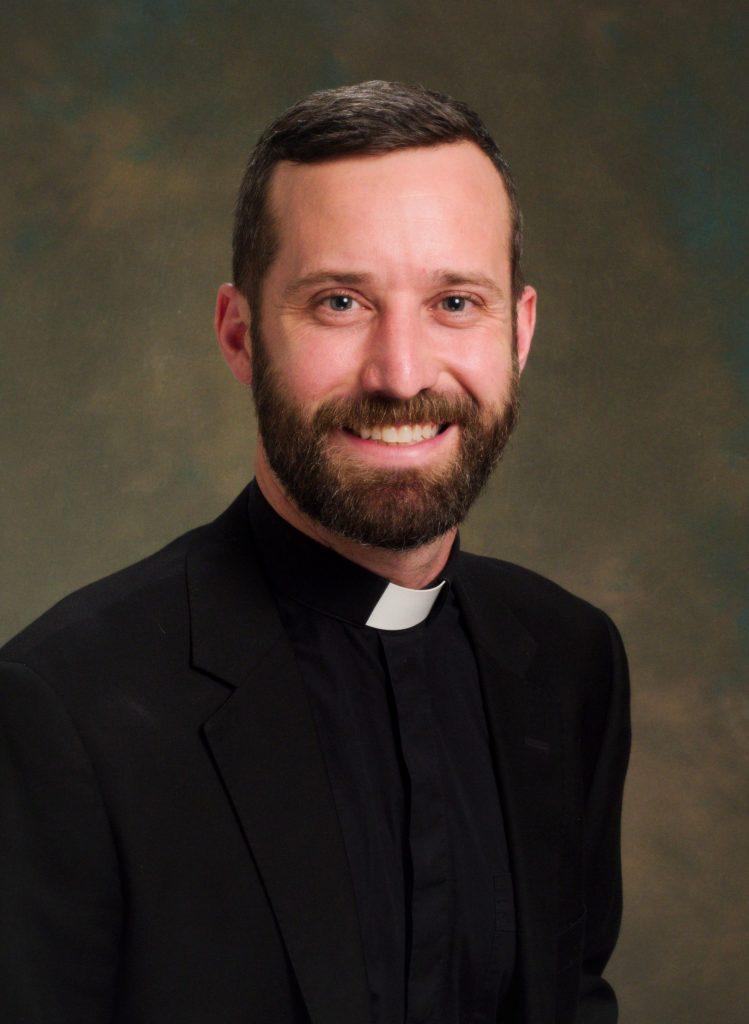 Father  Alex Roche