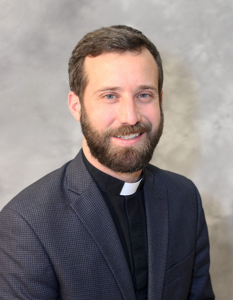 Father  Alex Roche